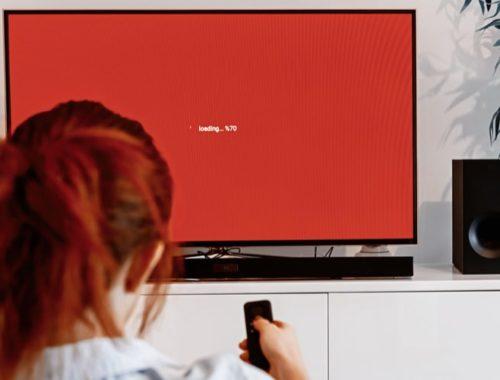 Person using a TV with a soundbar